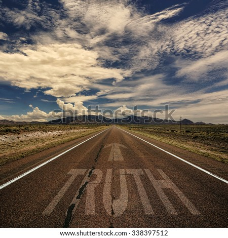 Conceptual image of desert road with the word truth and arrow - stock photo