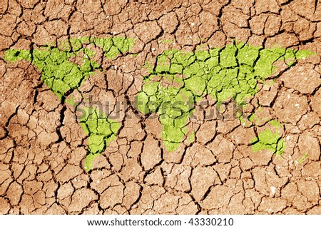 conceptual image of dried soil with flat world map