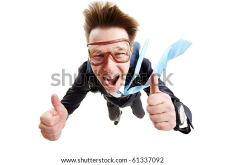 Conceptual image of happy man flying with parachute and showing thumbs up - stock photo