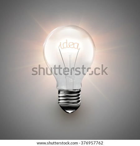 conceptual image of idea with a light bulb on light background