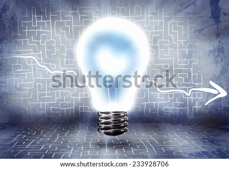 Conceptual image of light bulb and business sketches - stock photo