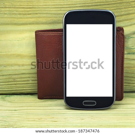 Conceptual image of mobile devise and regular wallet - stock photo