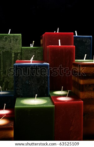 conceptual image of several perfect candle in black - stock photo