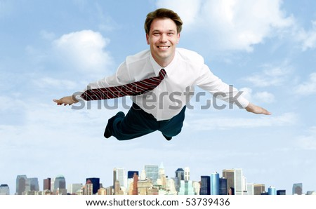 Conceptual image of smiling businessman flying in the clouds - stock photo