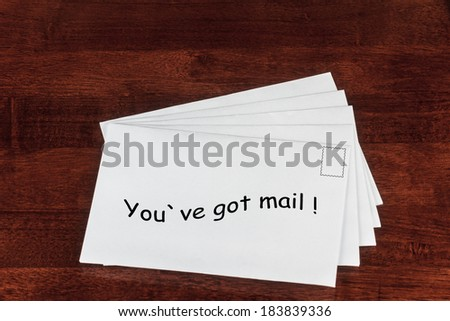 Conceptual Image of White Envelopes with You've Got Mail Print on a Table  - stock photo