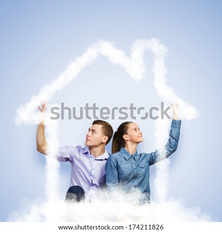 Conceptual image of young couple hugging each other and dreaming - stock photo