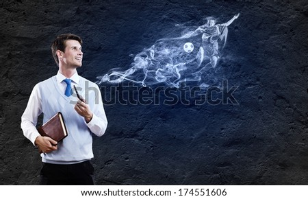 Conceptual image of young handsome man smoking pipe - stock photo