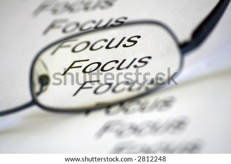 conceptual image representing focus with spectacles - stock photo