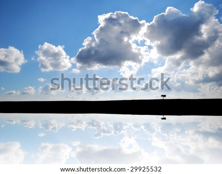 Conceptual image show distant view of lone tree with simulated water reflection - stock photo