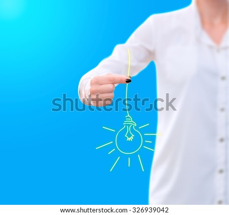 conceptual image , showing a woman holding a sketched light bulb - stock photo