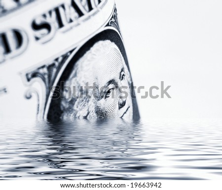 Conceptual image showing US dollars sinking in simulated water - stock photo