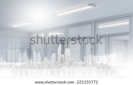 Conceptual image with construction model of buildings on table - stock photo