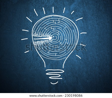 Conceptual image with drawn light bulb and labyrinth - stock photo