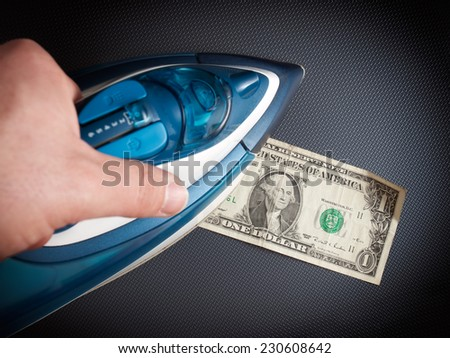 Conceptual image with iron and dollar about money laundry issues. - stock photo