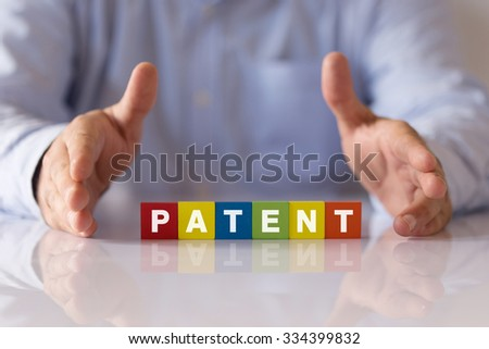Conceptual Image with the Word: PATENT on Colorful Wooden Cubes - stock photo