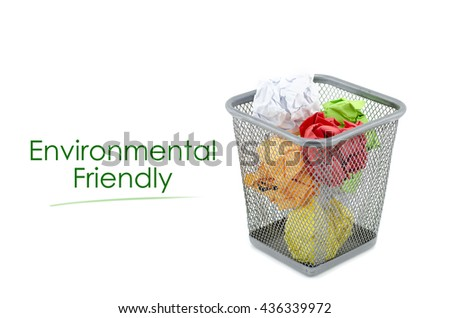 "conceptual image with word ""ENVIRONMENTAL FRIENDLY"" over crumple paper in metal dustbin and isolated white background - stock photo"