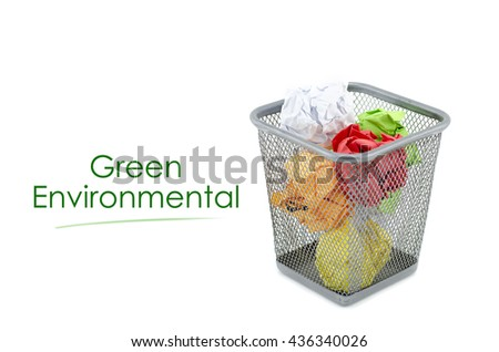 """conceptual image with word """"GREEN ENVIRONMENTAL"""" over crumple paper in metal dustbin and isolated white background - stock photo"""