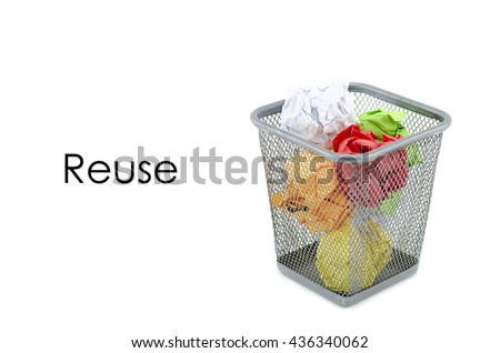 """conceptual image with word """"REUSE"""" over crumple paper in metal dustbin and isolated white background - stock photo"""