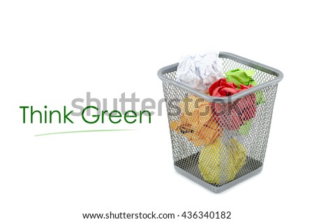 """conceptual image with word """"THINK GREEN """" over crumple paper in metal dustbin and isolated white background - stock photo"""
