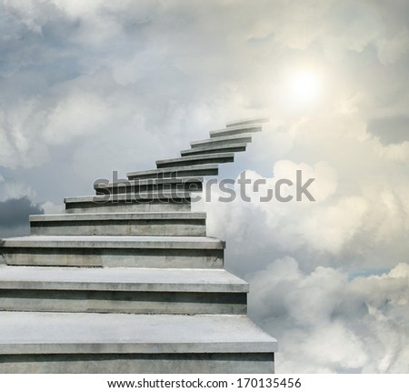 Conceptual of stairway over the sky in the clouds - stock photo