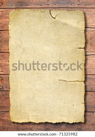 Conceptual old paper over a grungy wood background - stock photo