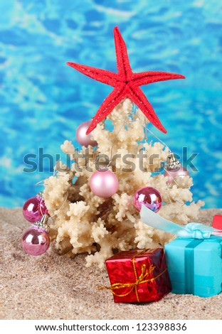 Conceptual photo: Celebrating Christmas at beach - stock photo