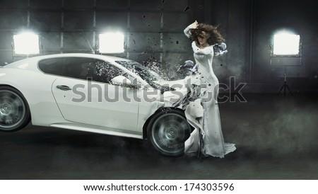 Conceptual photo of a crashed car - stock photo