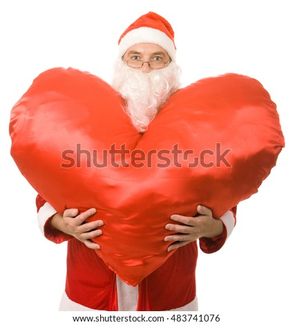 Conceptual photo of good santa claus having a big heart