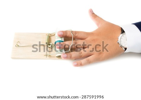 Conceptual photo of man got caught in mousetrap trying to steal money - stock photo