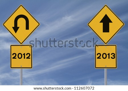 Conceptual road signs on the new year (against a blue sky background with copy space)