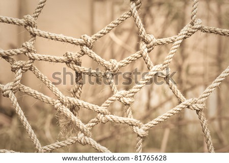 Conceptual sepia toned image of tangled rope