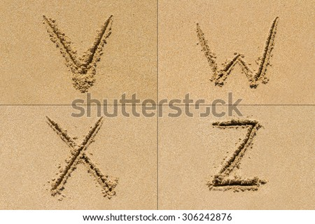 Conceptual set of V W X Z letter of the alphabet written on sand with upper case.