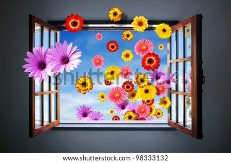 Conceptual Spring image with many colorful flowers entering through an open window - stock photo