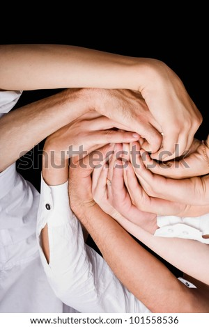 Conceptual symbol of multiracial human hands making a circle on white background - stock photo