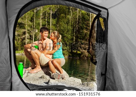 Conceptual View of a couple that camps from the inside of a tent