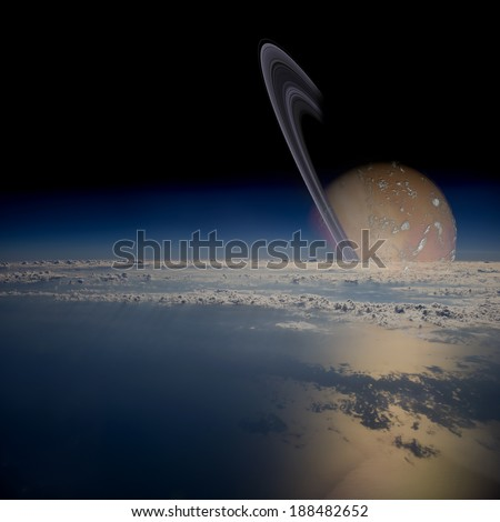 Conceptual view of a ringed planet in another planetary system. Elements of this image furnished by NASA.  - stock photo