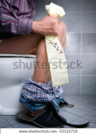 Conceptual view of digestive problems like constipation or diarrhea. - stock photo