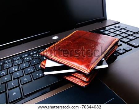 Conceptual view of on-line shopping with credit card,wallet and laptop... - stock photo