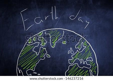 Conceptual world globe sketch on chalkboard, earth day idea - stock photo