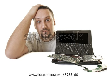 concerned about the young man has a problem with broken  laptop - stock photo