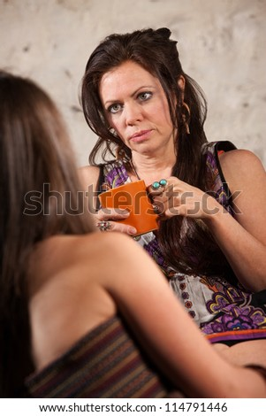 Concerned Caucasian brunette female listening to a friend - stock photo