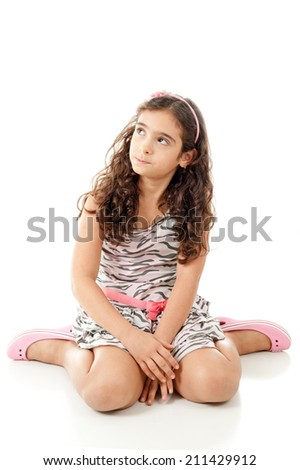 Concerned child looking at the side . - stock photo