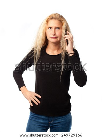 Concerned girl talking on mobile - stock photo
