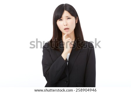 concerned Japanese businesswoman - stock photo
