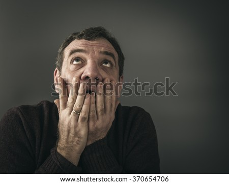 Concerned scared man - stock photo