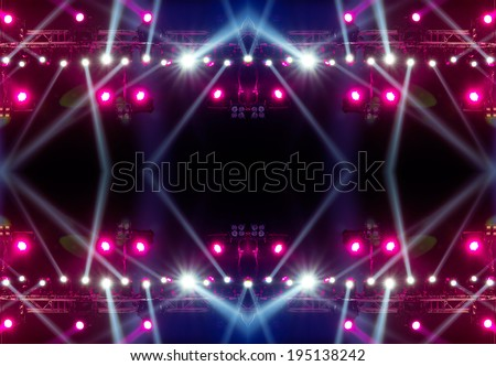 concert lighting against a dark background from the stage - stock photo