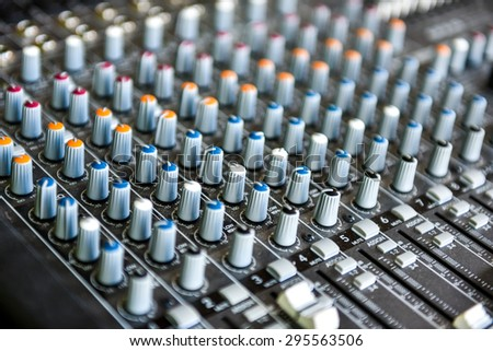 Concert or DJ Music Mixer desk. Sound control panel with knobs and sliders and equalizers - stock photo