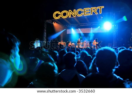 Concert Stage Many People Listening to Rock Group - stock photo