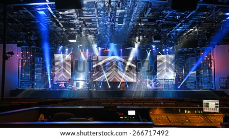 Concert stage with lights and musical instruments - stock photo