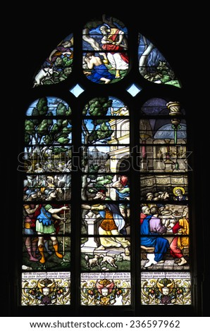 Conches, France - 14 June 2014 : Stained glass in french church. Scenes from the life of Jesus Christ : the roman at the door during the last supper - stock photo